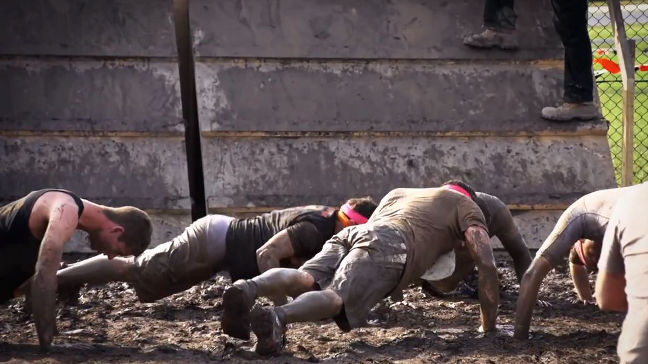 Right Mudders do push-ups while waiting
